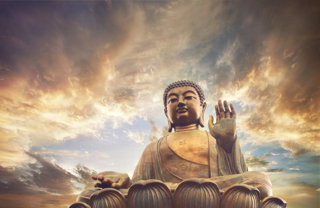 A picture of the Buddha against a golden-gray sky.