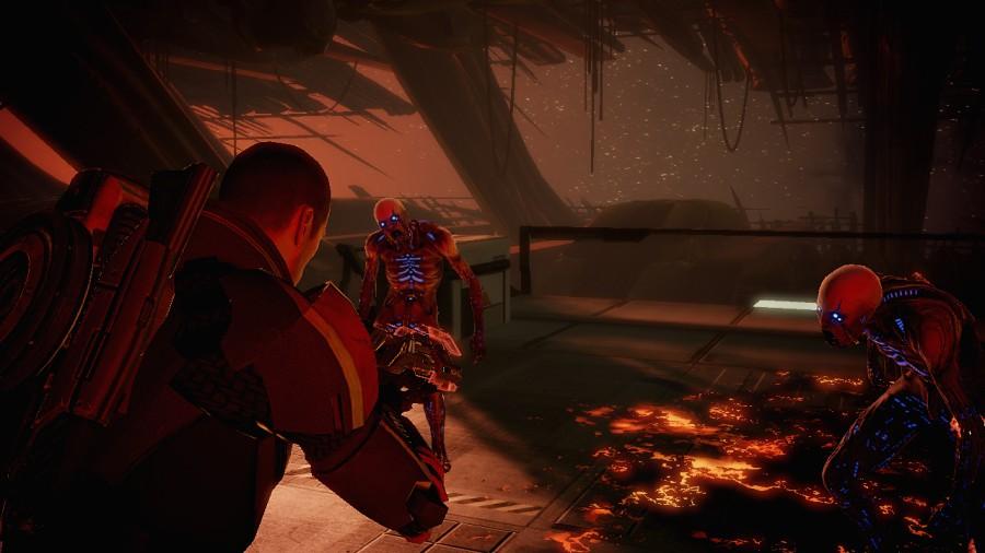 Mass Effect 2 gameplay screenshot: A pair of zombified enemies attacks Commander Shepherd.