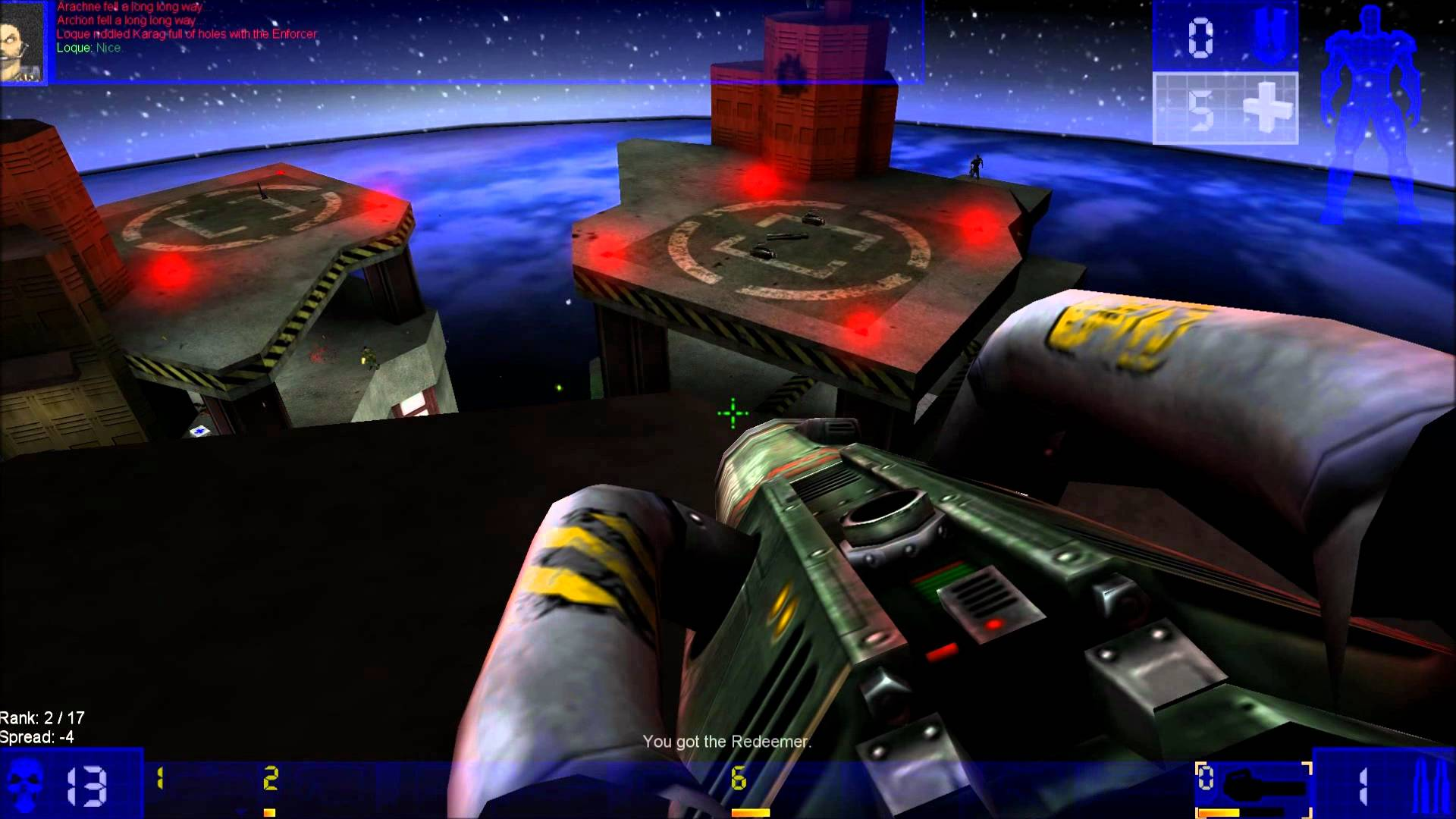 Gameplay footage from Unreal Tournament (1999). The player overlooks three skyscrapers, a giant gun in hand.
