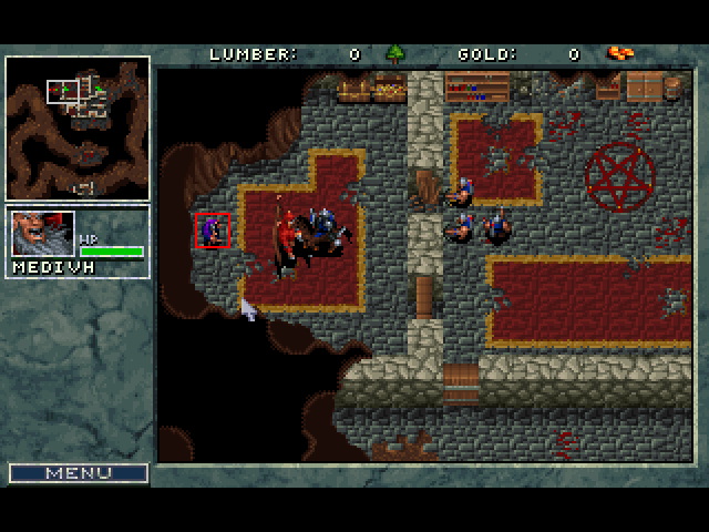 A screenshot of Warcraft, showing hero character Medivh summoning a giant, red daemon to attack the player.