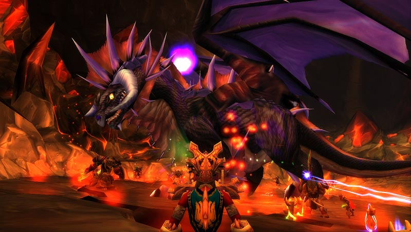 World of Warcraft screenshot: A mage overlooks a raid fight against Onyxia, a giant dragon boss.