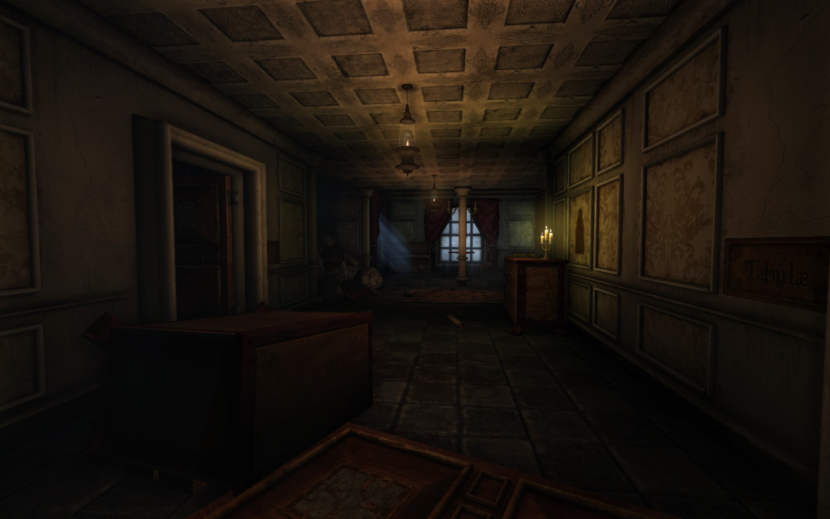 A surprisingly well-lit hallway in Amnesia. Yellow light reflects off the ceiling; a dresser is tipped over on the floor. Rubble can be seen in the background.