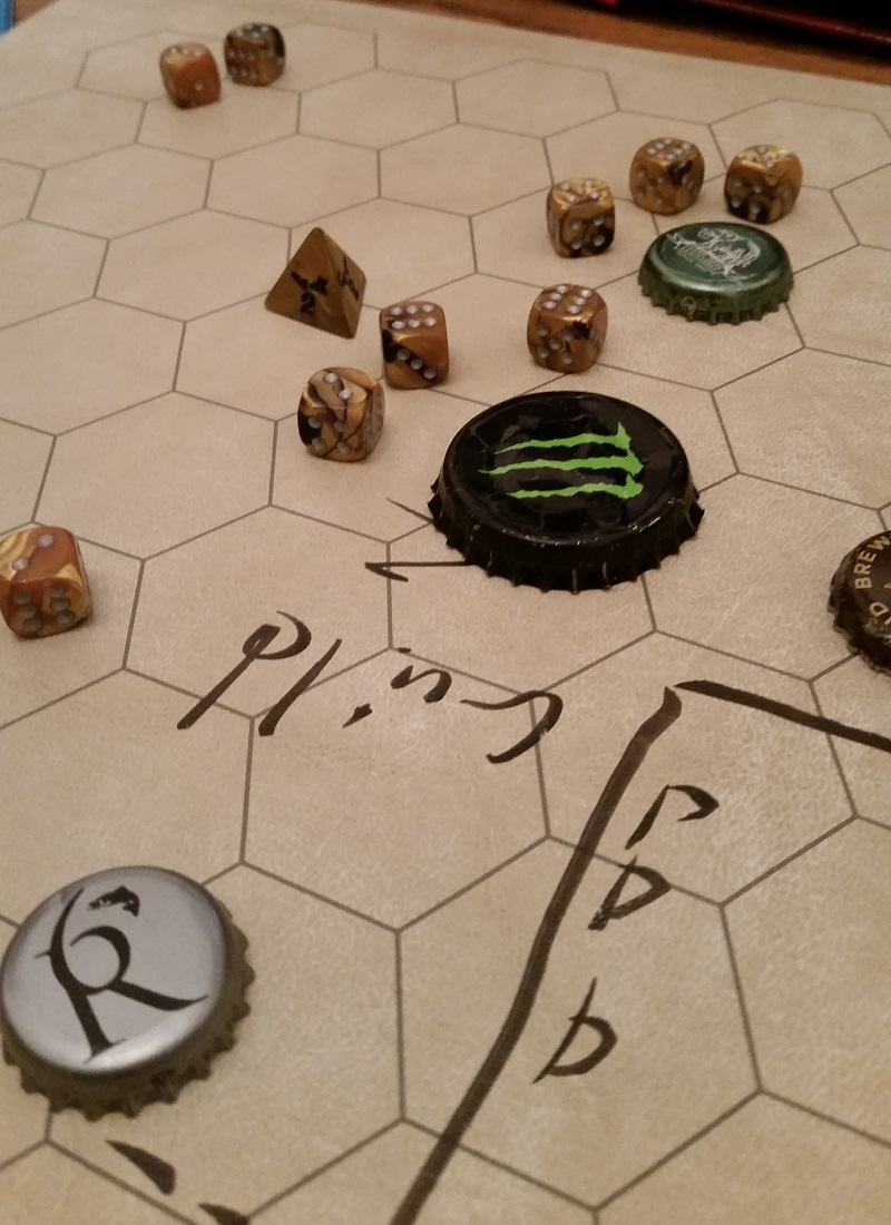 An array of dice and bottle caps, indicating monsters and players, are aligned over a hex-based board map.