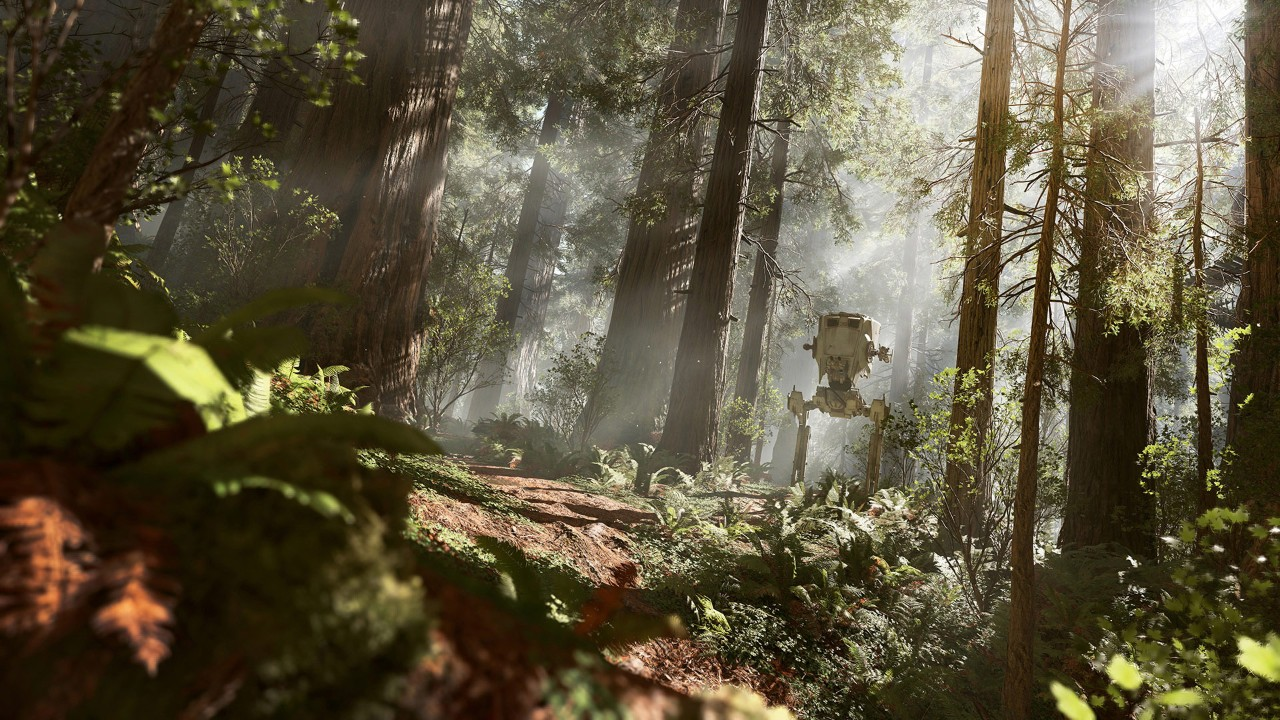 Star Wars Battlefront screenshot. A forest on Endor's moon. Hazy sunlight filters through tall trees with an Imperial AT-ST standing in the distance.