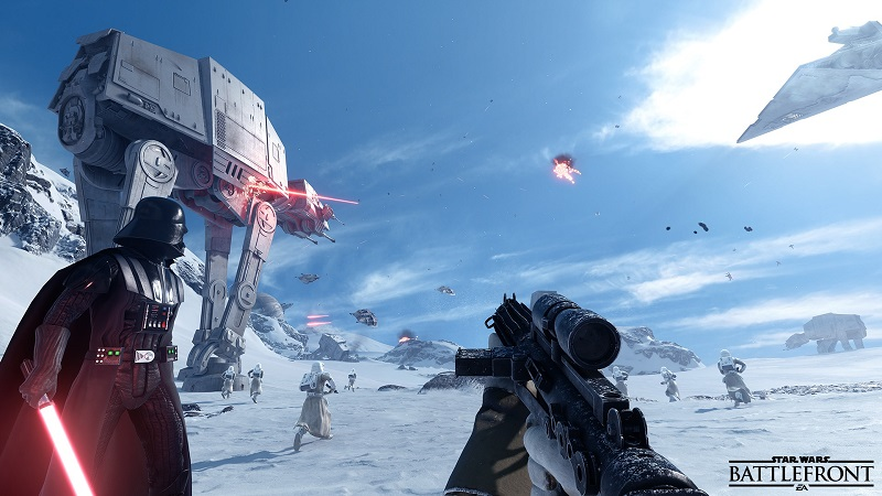 Star Wars Battlefront screenshot. First-person view of looking down the scope of an Imperial stormtrooper rifle. Darth Vader stands in command to the left while an AT-AT towers in the distance. Laser fire can be seen overhead against a blue Hoth sky.