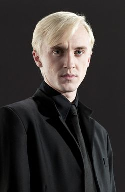 Draco Malfoy, dressed in black, looking angsty.
