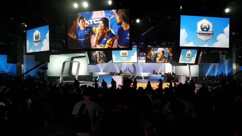 Team Sweden on a big screen TV amid the Overwatch Arena.